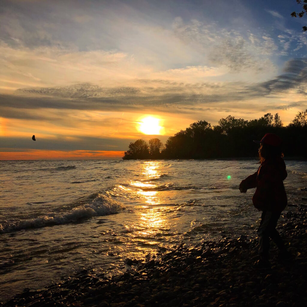 Skipping rocks at sunset at Presqu'ile Provincial Park