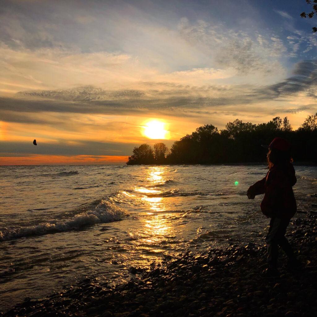 Skipping rocks at sunset at Presqu'ile Provincial Park