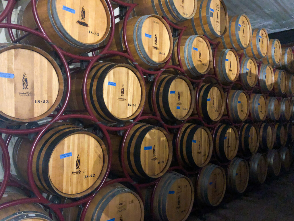 in the basement of Arrowhead Springs Winery - barrels and barrel of their wine in Niagara Wine Country, New York