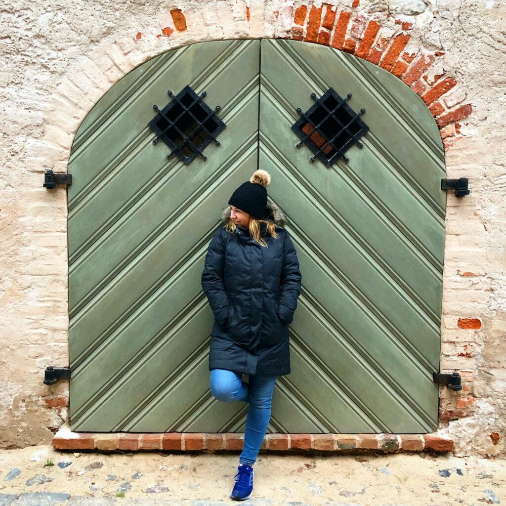 Gorgeous girl in front of door in Riga, Latvia #doortraits #doorsofeurope #doorsoflatvia #doorsofriga #rigadoors100 #magneticlatvia