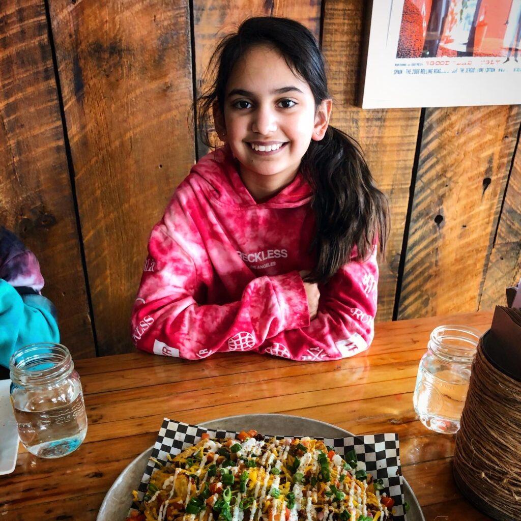 Miss M having tacos at Tucos Taco Lounger, Sudbury