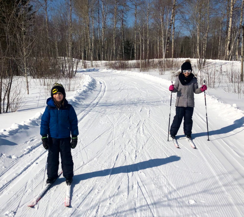 My kids cross country skiing in Kivi Park in Sudbury