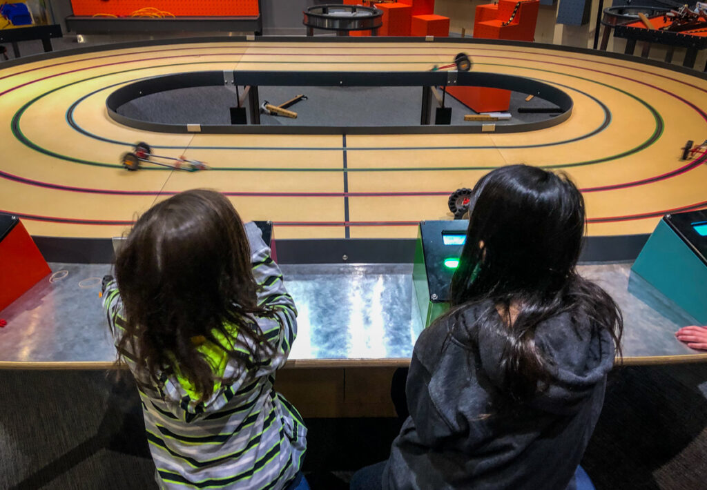 Racing the cars the kids made on the fourth floor of Science North