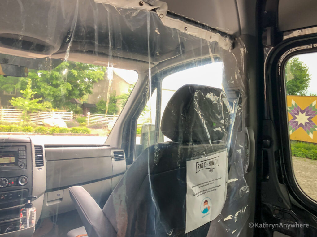 Inside the sprinter van with Ride The Bine - barrier between driver and passengers
