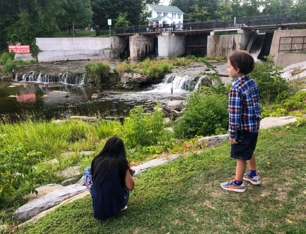 Kids in front of the dam in Gananoque