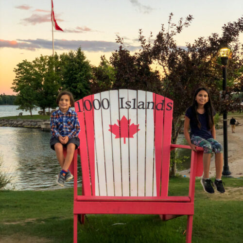 Gananoque, Ontario 1000 Islands kids on large chair with Canadian flag