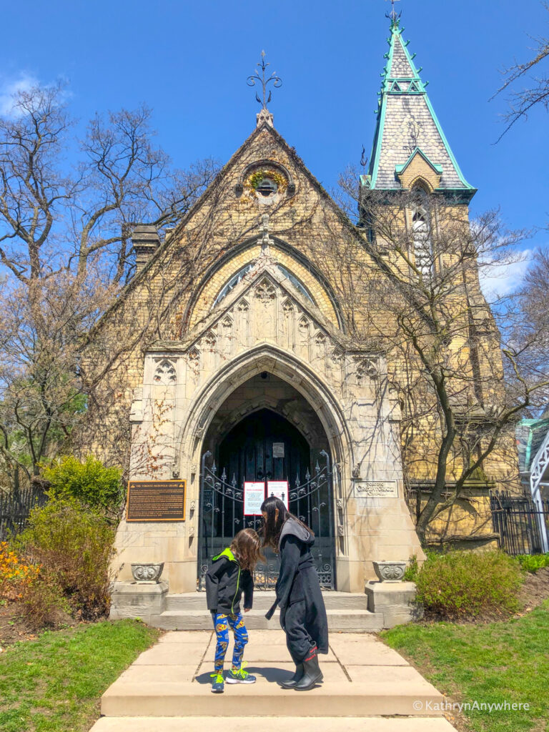Necropolis Cemetery Gate in Toronto with children in front of it