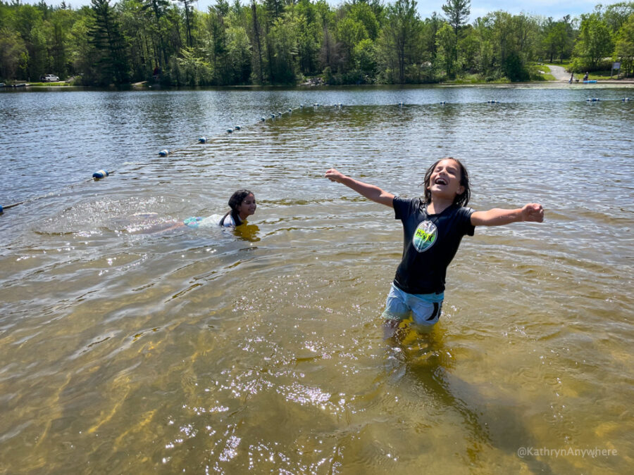 Six Mile Lake Provincial Park beach with kids playing