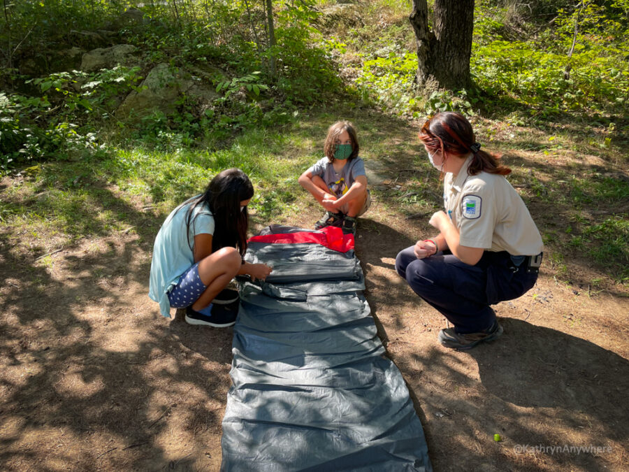 Six Mile Lake Learn To Camp - identifying the right spot to set up the tent and unrolling the tent.