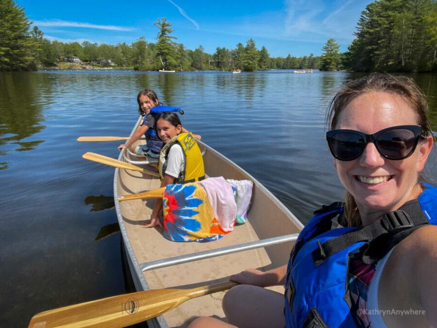 Six Mile Lake Canoe Rentals. Mom and kids in canoe.
