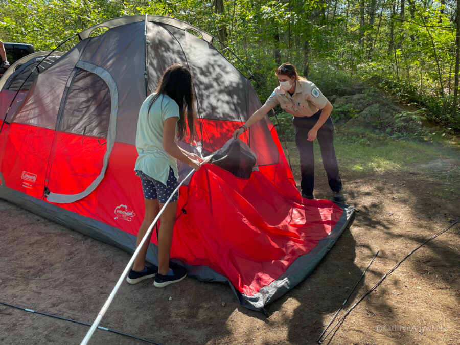 Six Mile Lake Provincial Park Learn To Camp. Putting poles through the tent to stand it upright.
