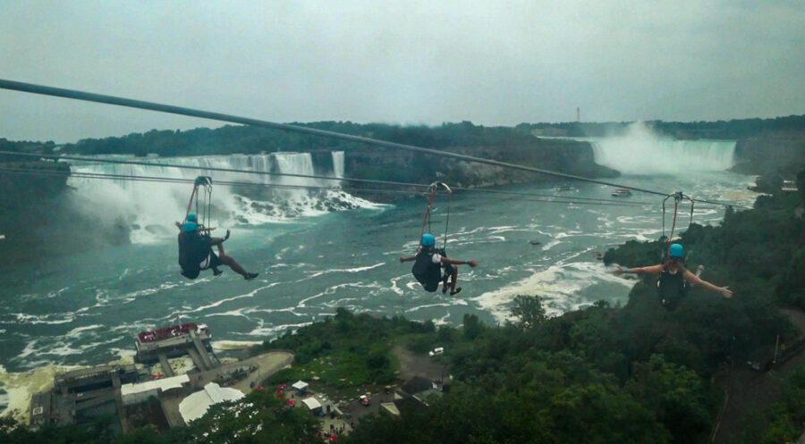 Zipline with 4 people on it. Wildplay Zipline To The Falls in Niagara Falls, Ontario